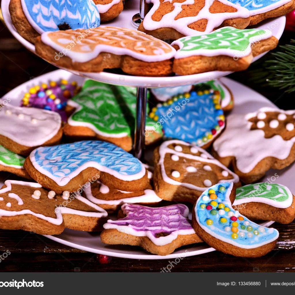 christmas-colored-cookies-with-covered-glaze-on-tiered-cookie