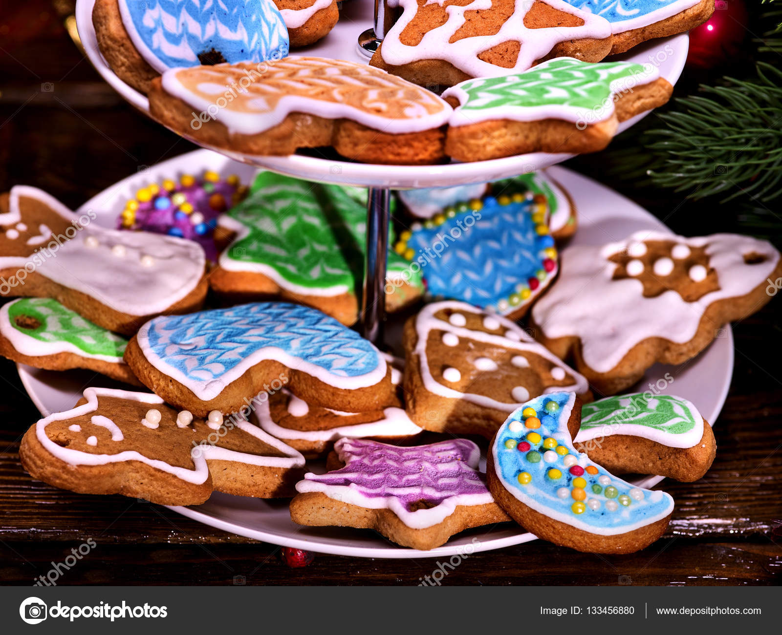 Christmas Colored Cookies With Covered Glaze On Tiered Cookie