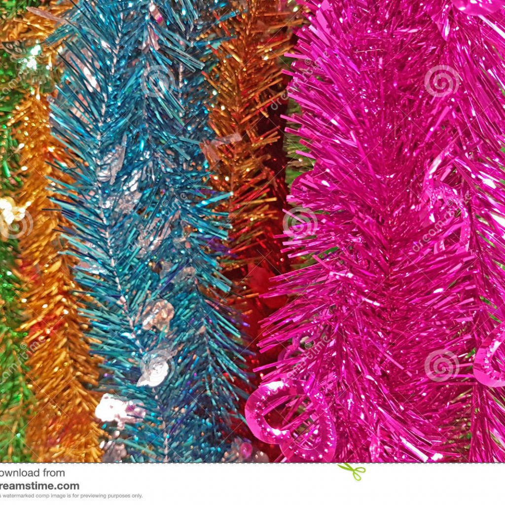 Christmas Colored Garland With Shiny Rainbow Foil Tinsel Stock Photo