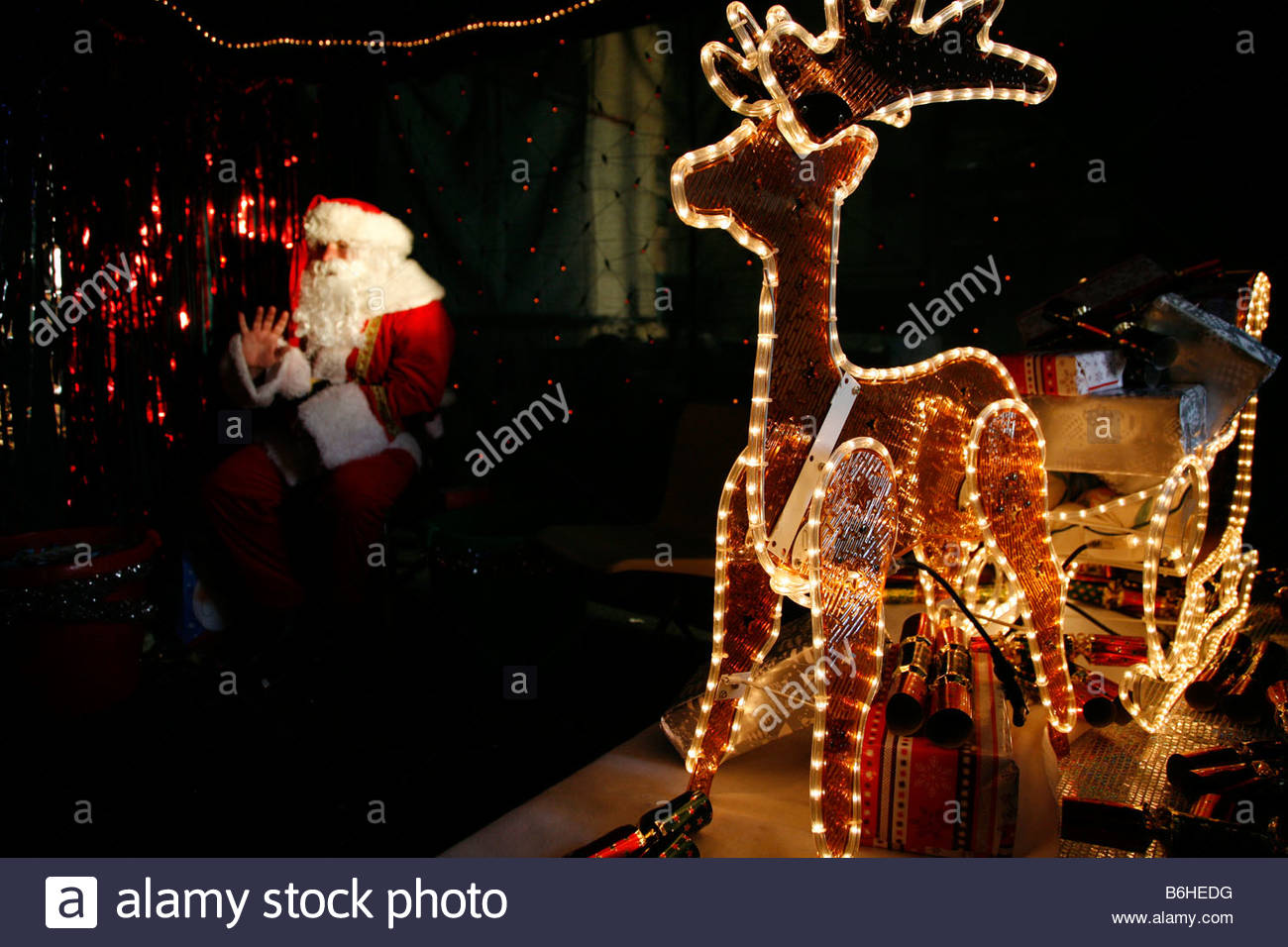Santa S Grotto Colouring Pages With Santas Stock Photos Images Alamy
