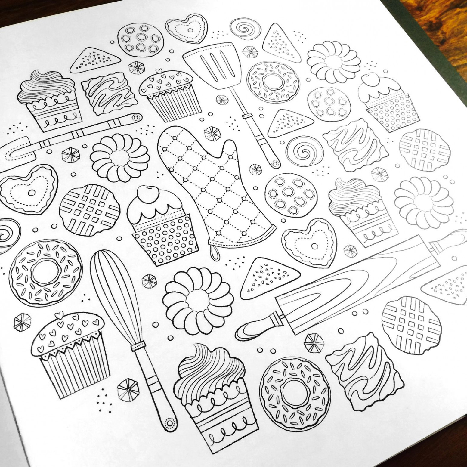 A hand-crafted coloring book for adults featuring intricate designs ..