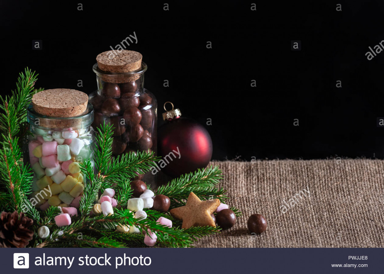 Christmas treats banner with bottles full of multi-colored mini ..