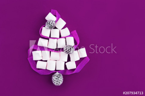 Christmas tree shape made of marshmallows and ribbon sweets on ..