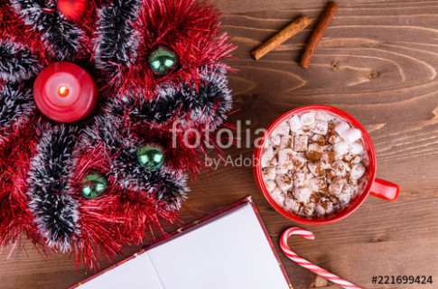 Christmas wreath made of multi-colored tinsel, candle, cocoa with ..